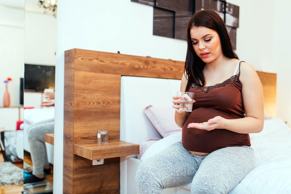 gravidă pastila pat apa